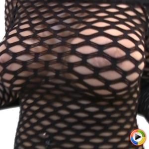 Alluring Vixens: Watch as the perfect busty babe Melanie Elyza teases in a skimpy black fishnet dress that barely leaves anything to the imagination at Alluring Vixens
