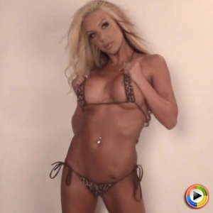 Alluring Vixens: Watch as busty blonde Alluring Vixen babe Kimmy teases in a skimpy little bikini