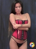 Watch as perfect Alluring Vixen Jada Cheng poses in a tight sexy red corset