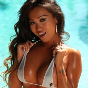 Alluring Vixens: Stunning Alluring Vixen tease Jada Cheng is by the pool in a skimpy shiny bikini top and tight little jean cutoffs