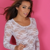 Alluring Vixen babe Amber teases in a semi sheer lace top with matching white panties