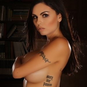 Alluring Vixens: Busty stunning Alluring Vixen babe Krystle Lina teases topless with just tight dot covered shorts on