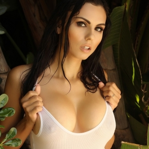 Big breasted Alluring Vixens babe Krystle Lina teases in a tight wet tank top that barely contains her big juicy tits outdoors