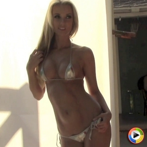 Blonde Alluring Vixen tease Aneta shows off her perfect curves in a skimpy shiny silver string bikini