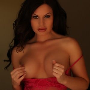 Alluring Vixens: Busty Alluring Vixen Charlie teases with her big tits in a sexy red lace outfit