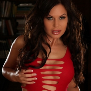 Curvy Alluring Vixen babe Charlie teases in a very slutty red dress with nothing on underneath