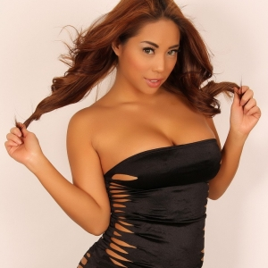 Alluring Vixens: Curvy Alluring Vixen tease Christine shows off in a very tight mini dress that doesn't leave much to the imagination