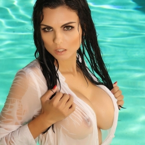 Alluring Vixens: Busty Alluring Vixen Krystle Lina shows off her massive fun bags in the pool while wearing a very see through white shirt and panties
