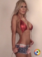 Watch as busty blonde babe Karly shows off her All American look in tiny jean cutoffs and a skimpy red bikini top