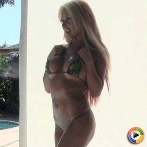 Watch as busty blonde Alluring Vixen babe Kimmy teases with her big tits in a very skimpy string bikini