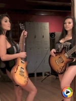 Busty babe Justene Jaro and her sexy friend tease in skimpy outfits with their guitars