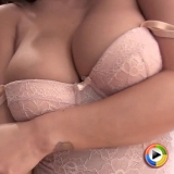 Watch as exotic babe Justene Jaro shows off her perfect curves in a pink lace body suit that barely contains her big juicy tits