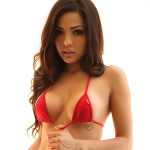 Stunning Alluring Vixen Karla shows off her perfect curves in a skimpy little red string bikini