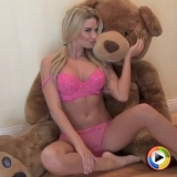 Watch as blonde Alluring Vixen babe Allie shows off her curves in hot pink matching bra and panties
