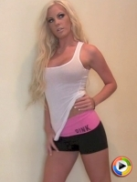 Blonde Alluring Vixen babe Ivy teases in her tight white tank top and sexy little shorts
