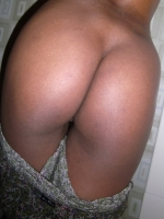 Black girlfriend takes selfshot pictures of her round booty in the bathroom