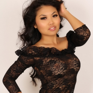 Alluring Vixens: Alluring Vixen tease Kat shows off her tight curves in a sexy black lace dress